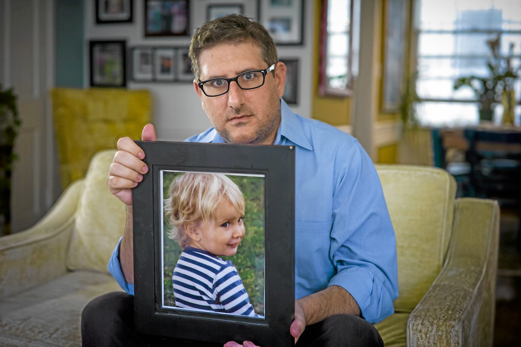 ". Larry Hummel of Beverly Hills, CA with a photo of his son Sasha, now 4, on Monday, November 11, 2013.  Hummel hasn\'t seen his son since May of last year. Hummel\'s ex-wife Maria Pfeifer, 32, of Hollywood was charged by the Los Angeles County District Attorney\'s Office in August with abducting Sasha and his half-brother Robert ""Jerry\"" Pfeifer, 10, after she took the children to the Czech Republic for a visit and never returned. An international hunt involving the F.B.I and the U.S. State Department is now underway to locate Maria Pfeifer.   ( Photo by David Crane/Los Angeles Daily News )"