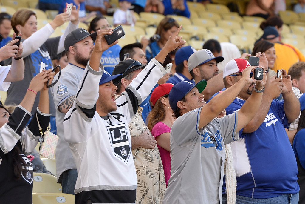. Fans take photos of the Cup as it enters the stadium. Members of the Los Angeles Kings brought the Stanley Cup to Dodger Stadium for photographs before the Dodgers played the Colorado Rockies.  Los Angeles, CA. 6/18/2014(Photo by John McCoy Daily News)