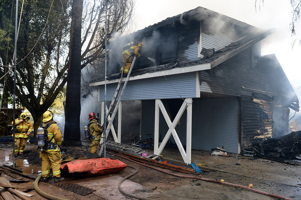 . Firefighters from Redlands, San Bernardino County and San Bernardino Fire Departments, Loma Linda, as well as Cal Fire battled a two-alarm fire that destroyed a historic home in Redlands on Wednesday, April 9, 2014. (Photo by John Valenzuela/ Redlands Daily Facts)