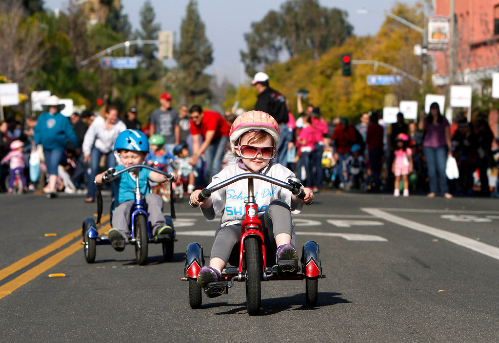 . Makenna Karrow, 3, of Riverside, participates in the public race portion of the Redlands Bicycle Classic on Saturday, April 5, 2014 in Redlands, Ca. (Photo by Micah Escamilla for the Redlands Daily Facts)