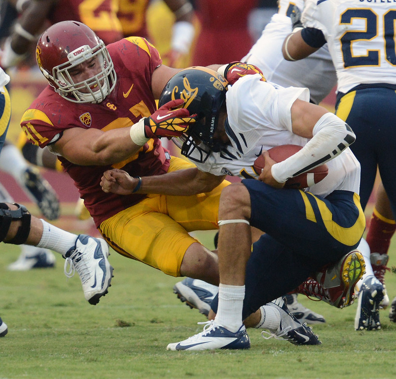 . USC\'s Morgan Breslin #91 sacks CAL QB Zach Maynard #15 in the second half during their game at Los Angeles Memorial Coliseum September 22, 2012. USC beat CAL 27-9. (Hans Gutknecht/L.A. Daily News)