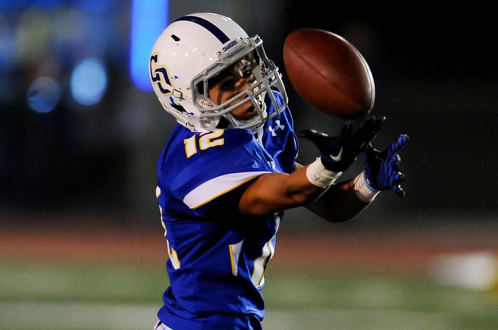 . Charter Oak\'s Joshua Padilla intercepts a Damien pass in the first half of a prep football game at Charter Oak High School in Covina, Calif., Friday, Oct. 11, 2013.    (Keith Birmingham Pasadena Star-News)