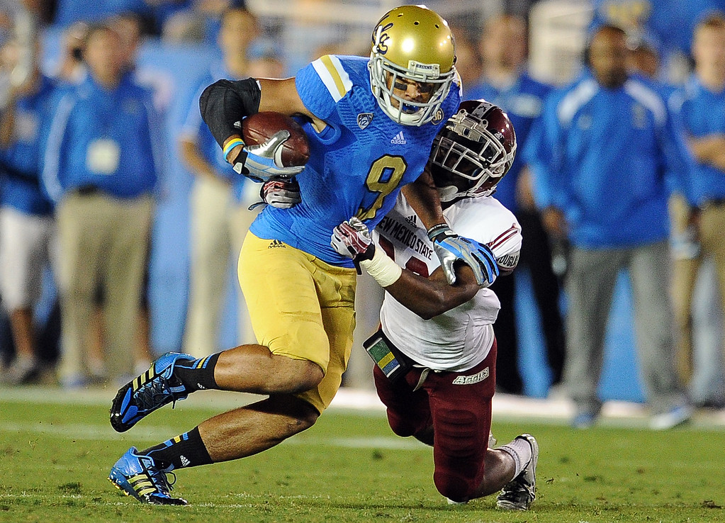 . UCLA wide receiver Jordan Payton (9) catches a ps for a first down against New Mexico State during the first half of their college football game in the Rose Bowl in Pasadena, Calif., on Saturday, Sept. 21, 2013.   (Keith Birmingham Pasadena Star-News)