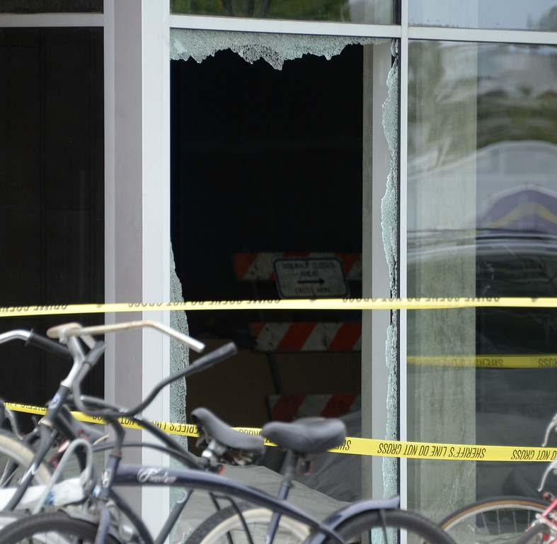 . May 24-,2014. Isla Vista, CA. One of the many windows blown out by gunfire from a  drive-by shooting that left seven people dead Friday night, including the attacker, and seven others wounded, authorities said Saturday.  The gunman got into two gun battles with deputies Friday night in the beachside community of Isla Vista before crashing his black BMW into a parked car. Photo by Gene Blevins/LA Daily News