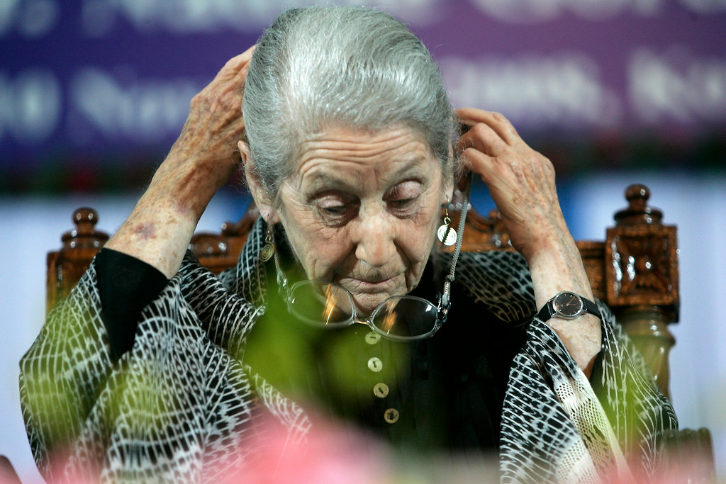 ". South African writer and Nobel laureate Nadine Gordimer, adjusts her glasses before delivering a speech titled ""The Inward Testimony\"" in Calcutta, India, Monday, Nov. 10, 2008. Gordimer,is in India on an invitation from the public diplomacy division of the Indian ministry of external affairs.(AP Photo/Bikas Das)"