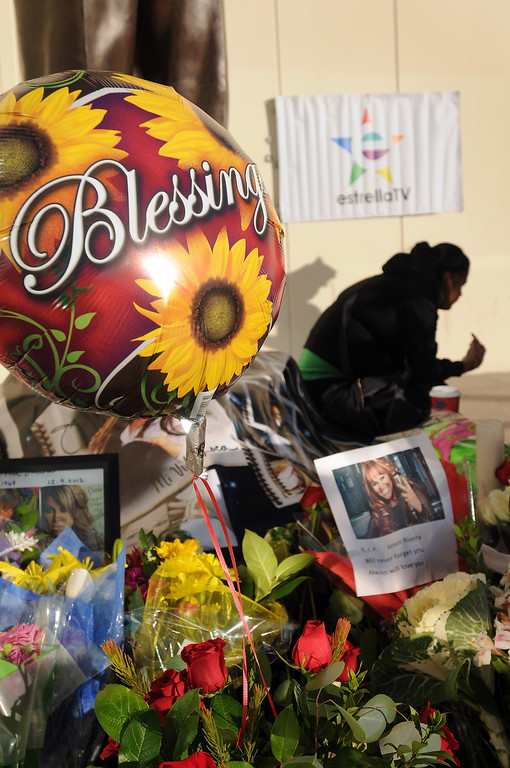 . Fans of singer Jenni Rivera gather at Liberman Broadcasting to pay tribute.  Guadalupe Alavarado, 24, came from Norwalk to Burbank to contribute to the memorial on December 10, 2012.  (Dean Musgrove/Los Angeles Daily News)