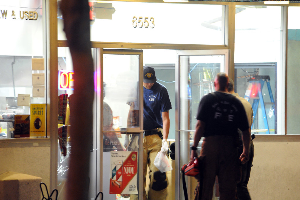 . In this image provided by the Santa Barbara Independent, police gather evidence at a small market, after a mass shooting near the campus of the University of Santa Barbara in Isla Vista, Calif., Friday, May 23, 2014. A drive-by shooter went on a rampage near the Santa Barbara university campus that left seven people dead, including the attacker, and others wounded, authorities said Saturday. (AP Photo/Santa Barbara Independent, Paul Wellman)