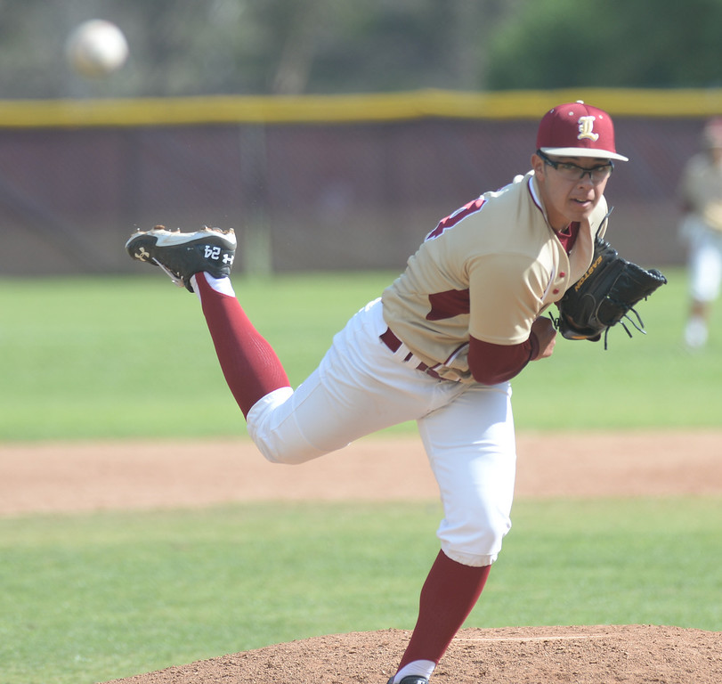 . La Serna\'s Enrique Pacheco (#24) makes a pitch as they play Santa Fe in their Del Rio League baseball game at La Serna High School in Whittier on Wednesday April 2, 2014. Santa Fe defeated La Serna 2-0. (Staff Photo by Keith Durflinger/Whittier Daily News)