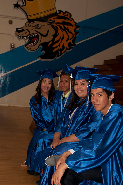 . Seniors cool off in the schools gym before the ceremony begins. The Reseda High School graduation class held their commencement in the school football field on Friday,  June 07, 2013 in Reseda, CA.   Photo by Carlos Carpio