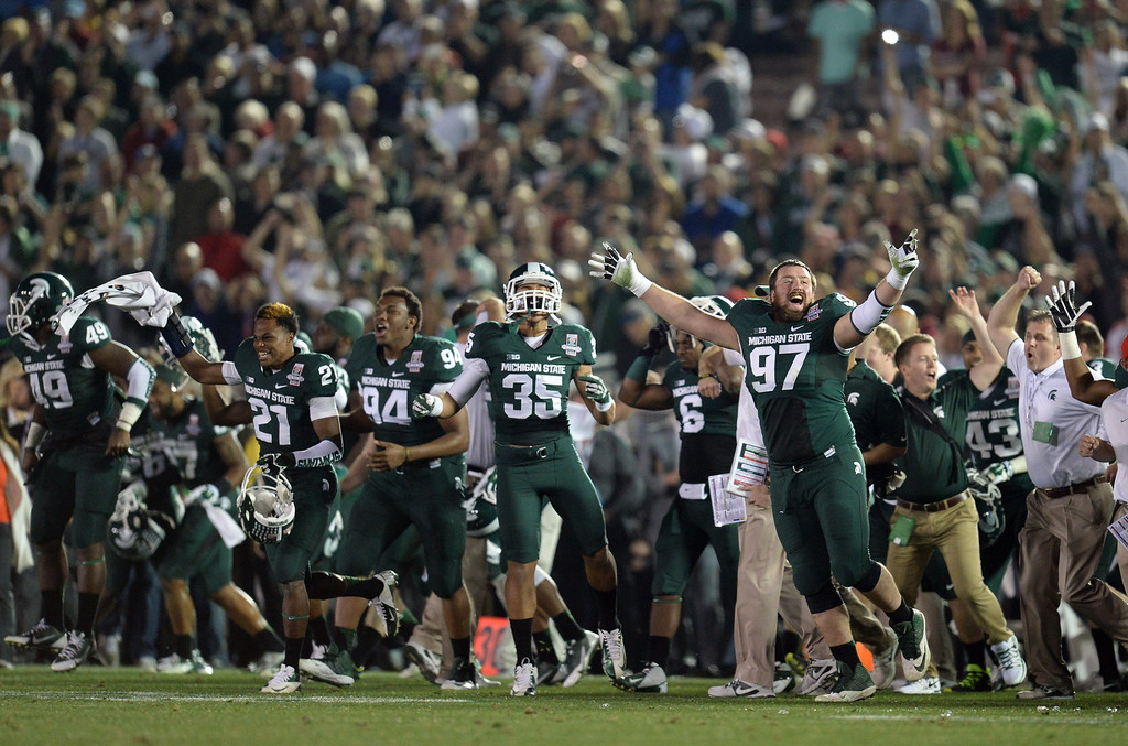 . Michigan State players run on to the field as time expires during the 100th Rose Bowl game in Pasadena Wednesday, January 1, 2014. Michigan State defeated Stanford 24-20. (Photo by Hans Gutknecht/Los Angeles Daily News)