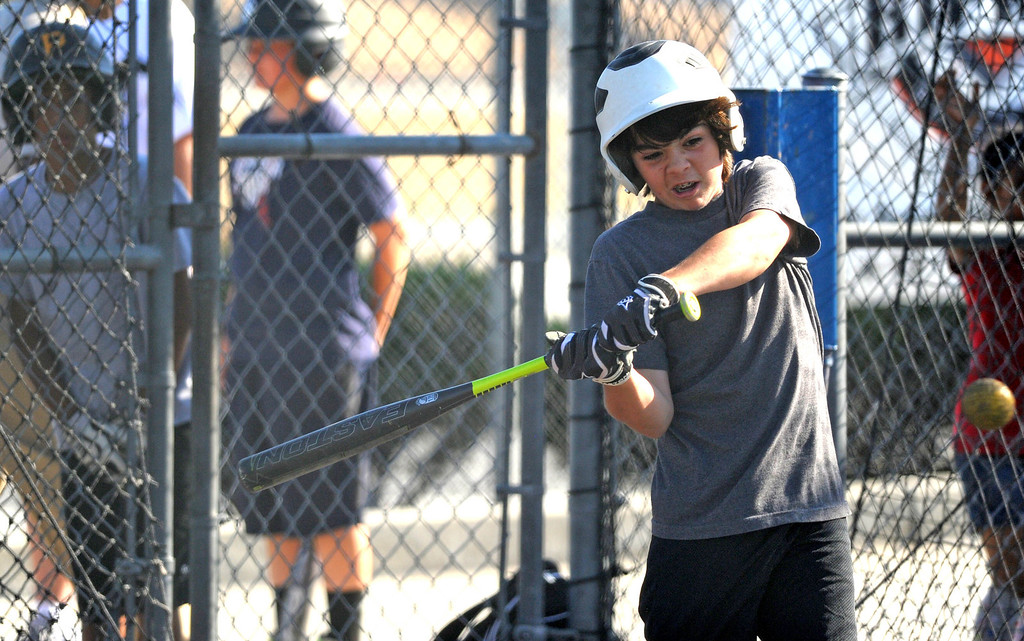 . 05-10-2013-(LANG Staff Photo by Sean Hiller)-  Lakewood Batting Cages located on Paramount and Cover Street is going out of business after 27 years  after their lease was not renewed. Caden Steele ,12, of the Lakewood Village Little League Major Pirates practices for a playoff game.