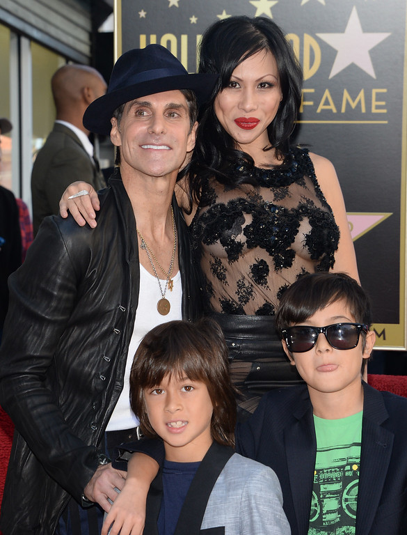 . Perry Farrell of the alt-rock band Jane\'s Addiction poses with his wife Etty Farrell and their children at the ceremony honoring Jane\'s Addiction with a star on The Hollywood Walk of Fame, October 30, 2013 in Hollywood, California.           (ROBYN BECK/AFP/Getty Images)
