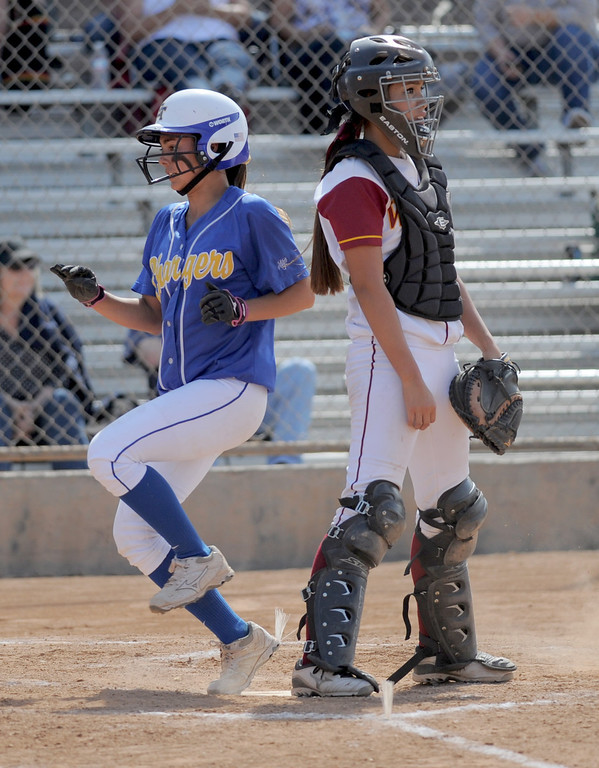 . 05-16-2013-( Daily Breeze Staff Photo by Sean Hiller) Wilson vs. El Toro in the opening round of the CIF-SS D2 playoffs Thursday at Joe Rodgers Field in Long Beach. Heather Nonora brings in a run for El Toro as Wilson\'s Alleah Laxamana waits fro the ball.