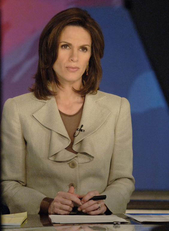 . In this photo released by ABC News, anchor person Elizabeth Vargas is seated on the set of World News Tonight at ABC News headquarters in New York City, Tuesday, Jan 3, 2006 on her first official day as co-anchor. (AP Photo/ABC, Donna Svennevk)