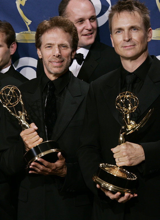 . The Amazing Race executive producer Jerry Bruckheimer, left, and host Jeff Probst hold awards for the outstanding reality-competition program at the 57th Annual Primetime Emmy Awards Sunday, Sept. 18, 2005, in Los Angeles.   (AP Photo/Kevork Djansezian)