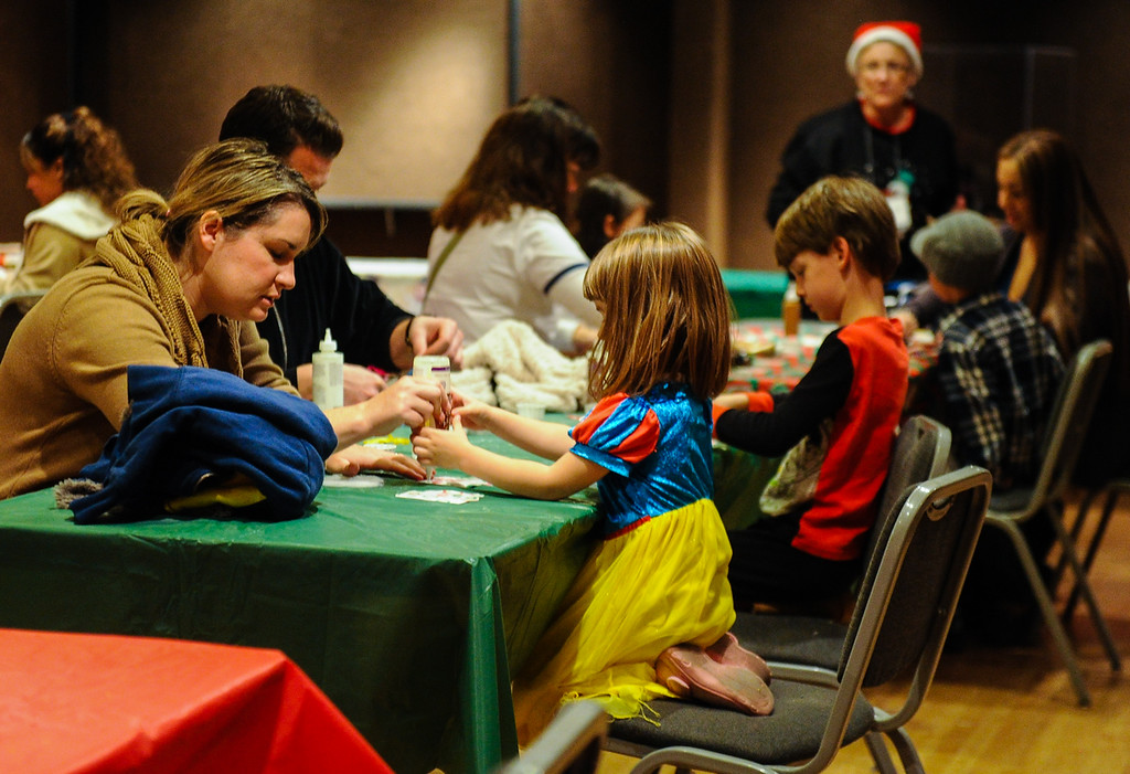 . Children make holiday ornaments with their parents during the annual Santa Pajama Party at the San Bernardino County Museum in Redlands on Friday, Dec. 6, 2013. (Photo by Rachel Luna / Redlands Daily Facts)