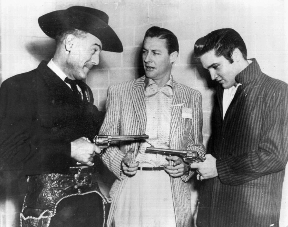 ". Elvis Presley, right, and Horace Logan, left, pose with disc jockey Ed Hamilton backstage at the Louisiana Hayride in Shreveport, La., in an undated photo. In October 1954 Logan introduced the teen-age Elvis Presley to America by saying ""Ladies and gentlemen, you\'ve never heard of this young man before, but one day you\'ll be able to tell your children and grandchildren you heard musical history made tonight.\""  (AP Photo/Louisiana Hayride)"