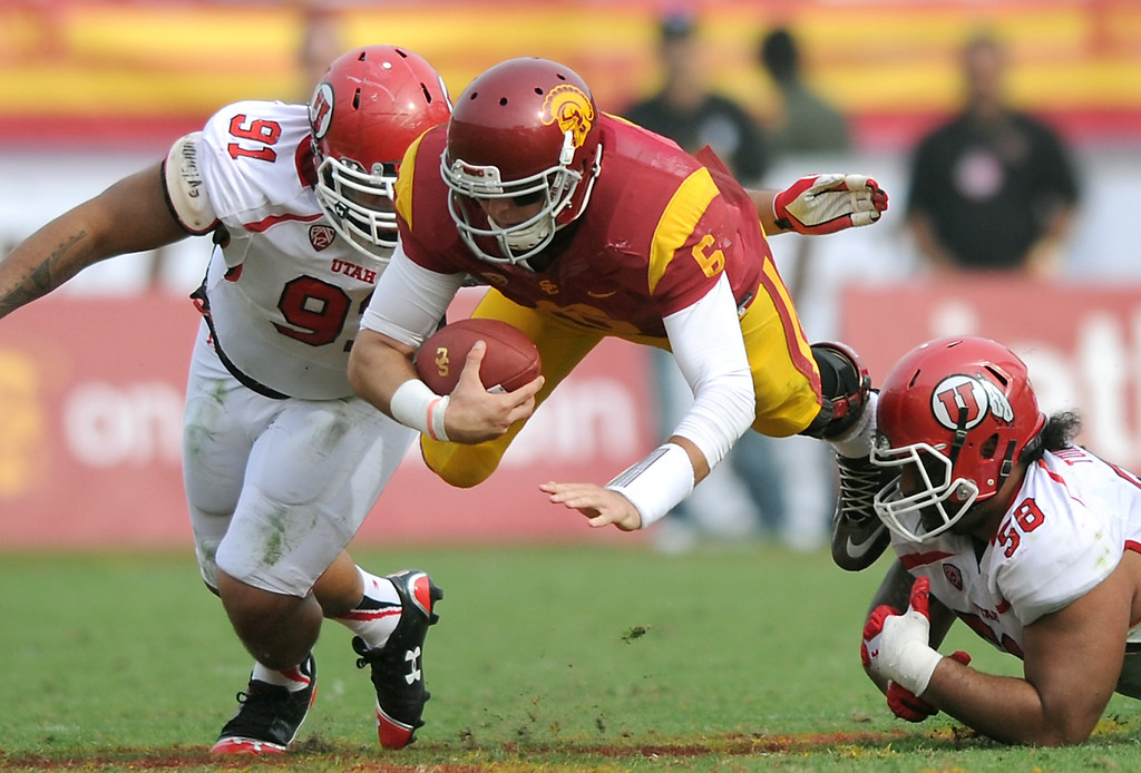 . USC QB Cody Kessler is tripped up by Utah in the third-quarter, Saturday, October 26, 2013, at the L.A. Memorial Coliseum. (Michael Owen Baker/L.A. Daily News)