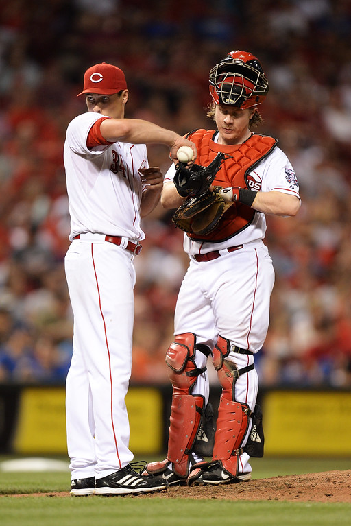 . CINCINNATI, OH - SEPTEMBER 8:  Pitcher Homer Bailey #34 of the Cincinnati Reds and catcher Ryan Hanigan #29 of the Cincinnati Reds talk on the mound in the sixth inning against the Los Angeles Dodgers at Great American Ball Park on September 8, 2013 in Cincinnati, Ohio. Cincinnati defeated Los Angeles 3-2 to sweep the series.  (Photo by Jamie Sabau/Getty Images)