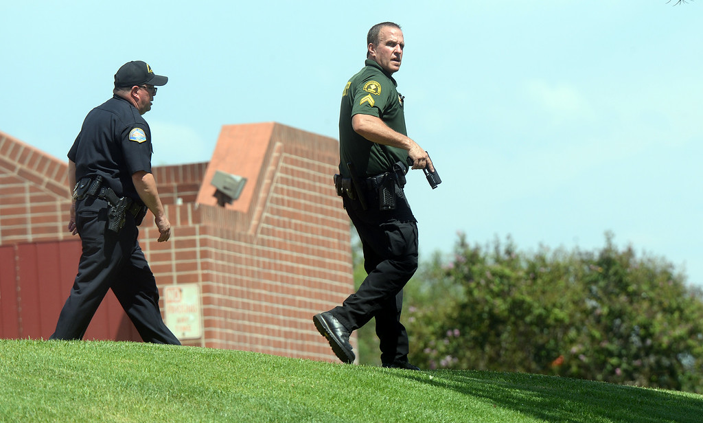 . Armed sheriff deputies and Chaffey College police search the campus Thursday for a suspicious man on campus. The Chaffey College campus in Rancho Cucamonga was lockdown by campus police at approximately 1:15 p.m Thursday August 21, 2014 after a report was made about a maie with anti-goverment patches on his vest, wearing black combat boots, black pants and a black backpack. The threat was never confirmed and no one was taken into custody. The campus was under lockdown for over an hour before it was lifted. Classes have been cancelled for the rest of the day.  (Will Lester/Inland Valley Daily Bulletin)