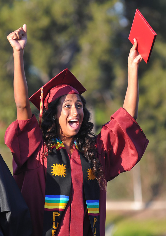 . Melissa Lopez cheers to her family after receiving her diploma during La Serna High School\'s 51st Annual Commencement at La Mirada High School stadium in La Mirada on Thursday June 13, 2013. La Serna marked the commencement of 635 graduates and marking Principal Ann Fitzgerald\'s first graduation as principal. (SGVN/Staff Photo by Keith Durflinger)