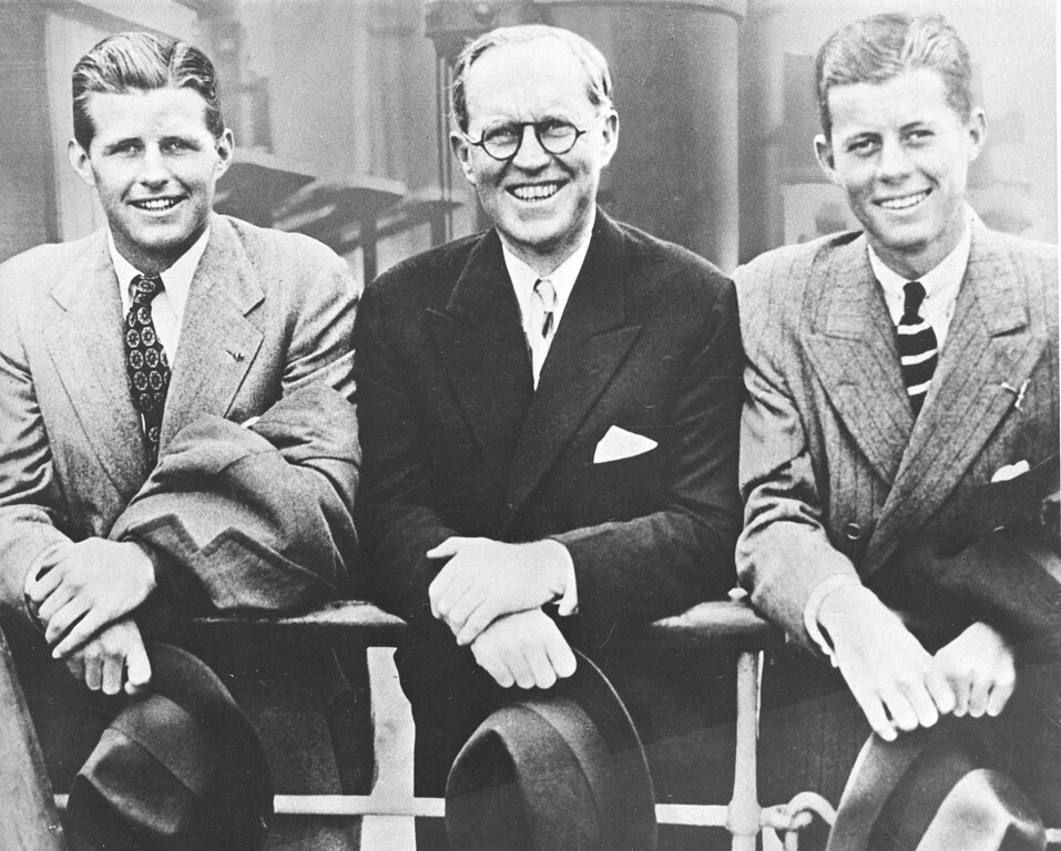. U.S. Ambassador to Great Britain Joseph P. Kennedy, center, is flanked by his sons, Joseph P. Kennedy Jr., left, and John F. Kennedy, right, as he poses aboard an ocean liner in this 1938 photograph. (AP Photo)