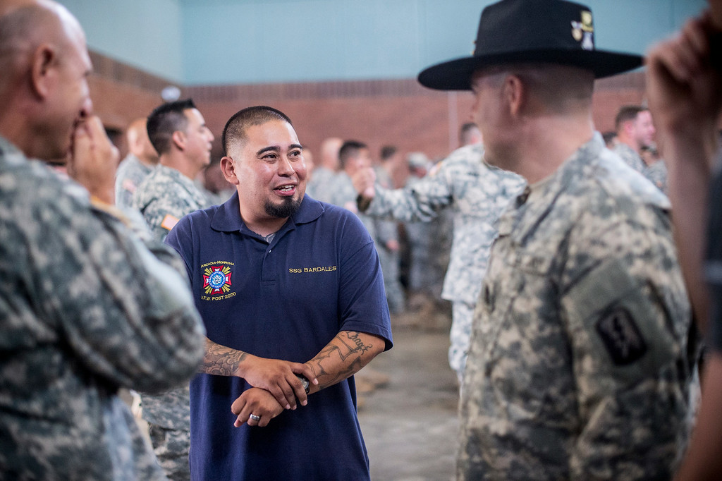 . Sgt. Luis Bardales, a resident of Irwindale who works for the city of South Pasadena, receives a Purple Heart at the Army National Guard in Azusa Saturday, July 12, 2014. Bardales was wounded by a roadside IED in Baghdad, Iraq and saved gunner Gabriel Herrera by pulling him out of their Humvee before another IED explosion. (Photo by Sarah Reingewirtz/Pasadena Star-News)