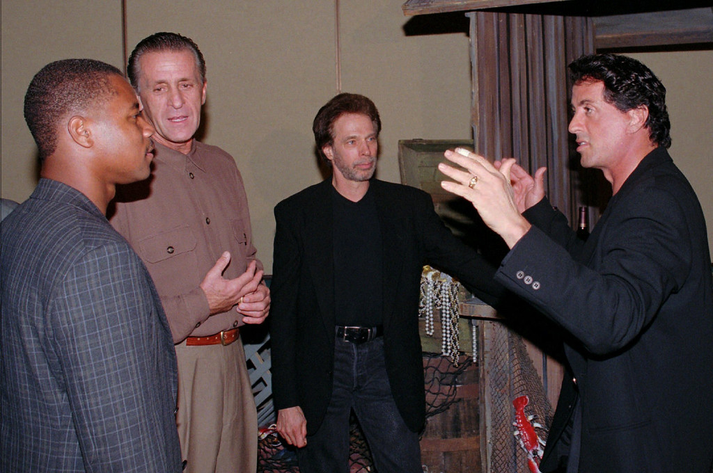 . Actor Sylvester Stallone, right, isn\'t about to use karate as he talks with, from left, fellow actor Cuba Gooding, Jr., Miami Heat coach Pat Riley, and producer Jerry Bruckheimer; he\'s was only involved in a lively discussion. Stallone and friends were at a party held for guests before the opening of the new Planet Hollywood in Fort Lauderdale, Fla., Sunday, Nov. 2, 1997. (AP Photo/Gregory Smith)