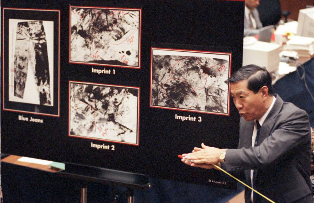 . Defense forensic expert scientist Dr. Henry Lee explains to the jury possible shoe imprints on murder victim Ron Goldman\'s blood-stained jeans (photos in background) 23 August during direct examination by defense attorney Barry Scheck in the O.J. Simpson trial. The defense is trying to prove that these imprints are from a second assailant.    (POO/AFP/Getty Images)