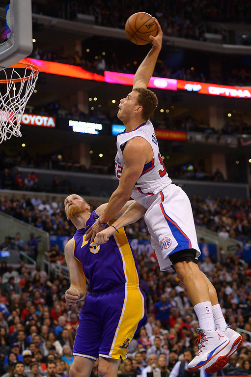 . Clippers Blake Griffin goes for a monster dunk over the Lakers Chris Kaman in the first half, Friday, January 10, 2014, at Staples Center. (Photo by Michael Owen Baker/L.A. Daily News)