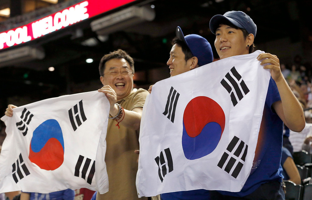 . Los Angeles Dodgers fans wave South Korean flags as they cheer on pitcher Hyun-Jin Ryu, of South Korea, in the third inning of a baseball game against the Arizona Diamondbacks on Monday, Sept. 16, 2013, in Phoenix. (AP Photo/Ross D. Franklin)