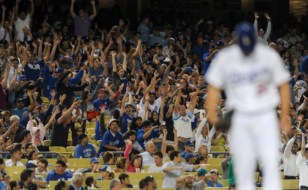 . The wave makes its way around the field with Clayton Kershaw on the mound, Friday, July 12, 2013, at Dodger Stadium. (Michael Owen Baker/Staff Photographer)