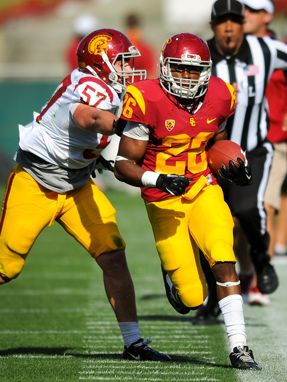 . USC RB James Toland is forced out by LB Nick Schlossberg at the spring game. (Photo by Michael Owen Baker/L.A. Daily News)
