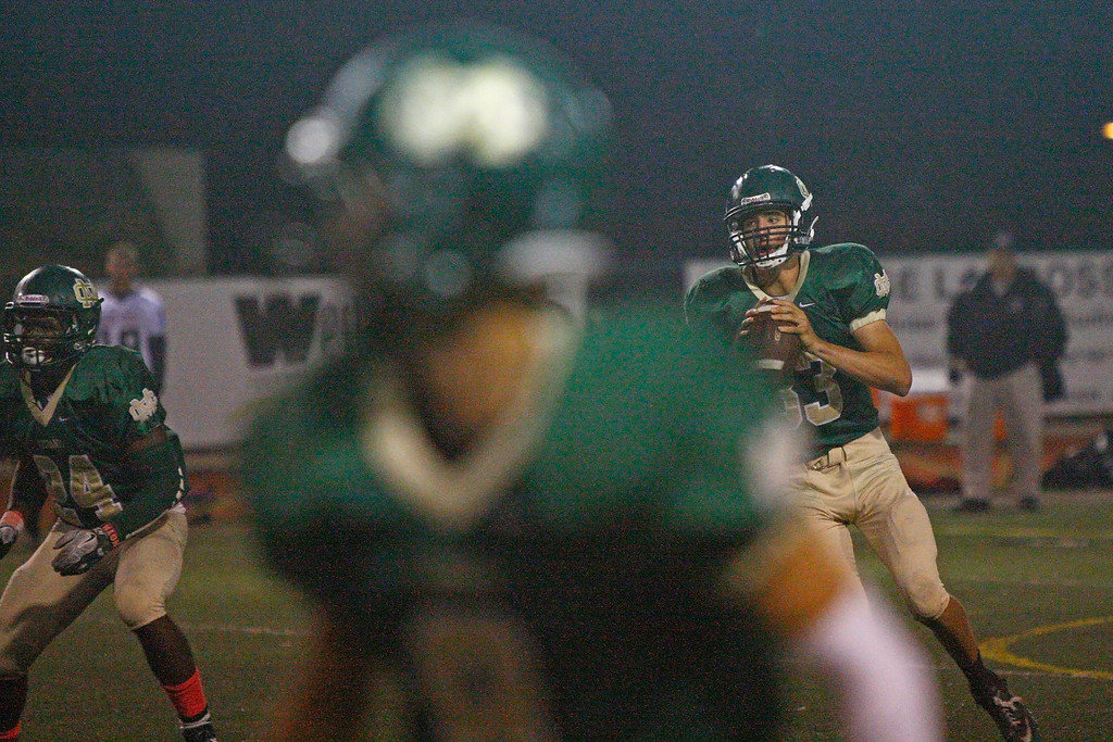 . Quarterback Greg Briskin #33 of Mira Costa drops back to pass against the defense of Palos Verdes during a Bay League matchup at Mira Costa High School on Friday, October 18, 2013 in Manhattan Beach, Calif.  (Michael Yanow / For the Daily Breeze)