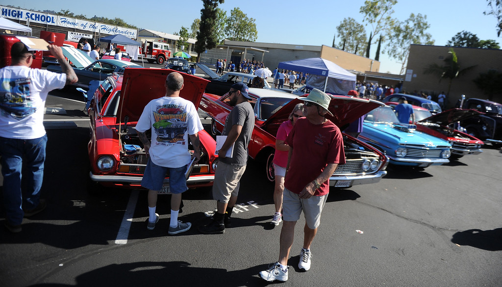 . Locals look through over a 100 classic cars and trucks during the 4th annual La Habra Highlanders car show at La Habra High School in La Habra Calif. on Saturday, Sept. 7, 2013.   (Photo by Keith Birmingham/Pasadena Star-News)