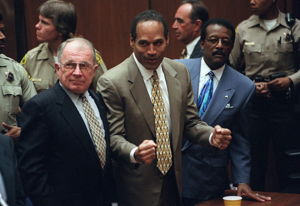 . This Oct. 3, 1995 file photo shows O.J. Simpson, center, with defense attorneys F. Lee Bailey, left, and Johnnie Cochran after Simpson was found not guilty of murdering his ex-wife Nicole Brown Simpson and her friend Ron Goldman at the Criminal Courts Building in Los Angeles.  (Los Angeles Daily News file photo)