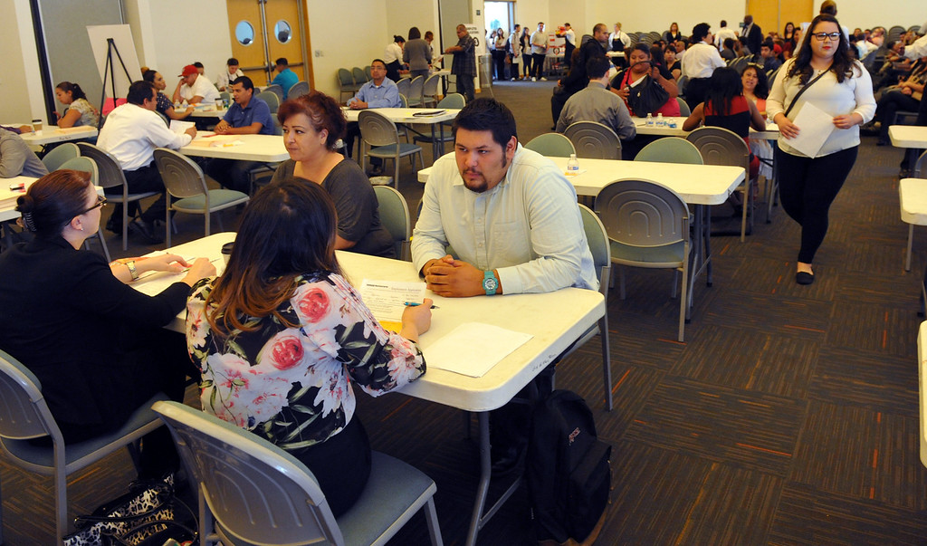 . Job seekers are interviewed at Pico Park for the new Norm\'s Restaurant in Pico Rivera on Friday  May 2, 2014. Over 1,000 people are expected to fill out applications for the Pico Rivera Norms that will open on May 22nd.  (Staff Photo by Keith Durflinger/Whittier Daily News)