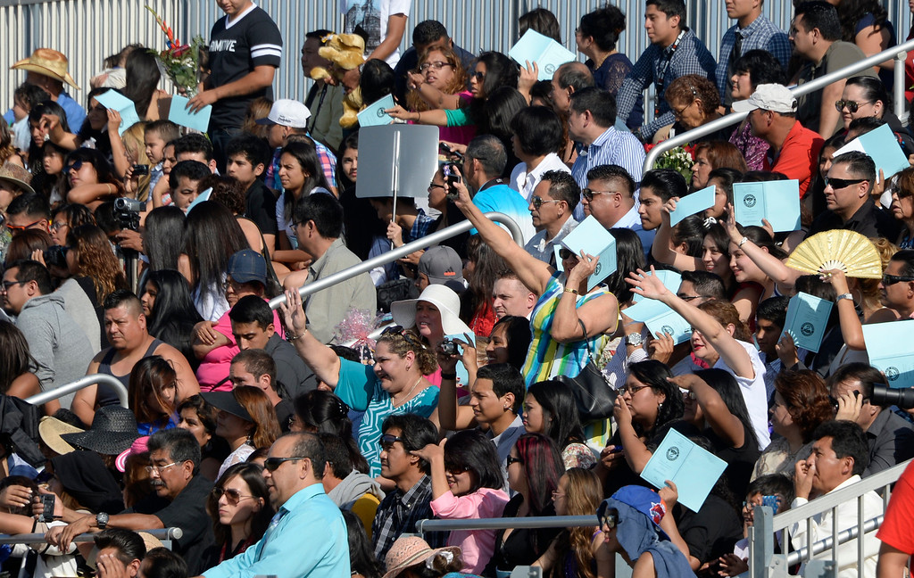 . June 6,2014 PANORAMA city, California. Parents wave to their kids during the Panorama High graduating class of 2014. Photo by Gene Blevins/LA Daily News