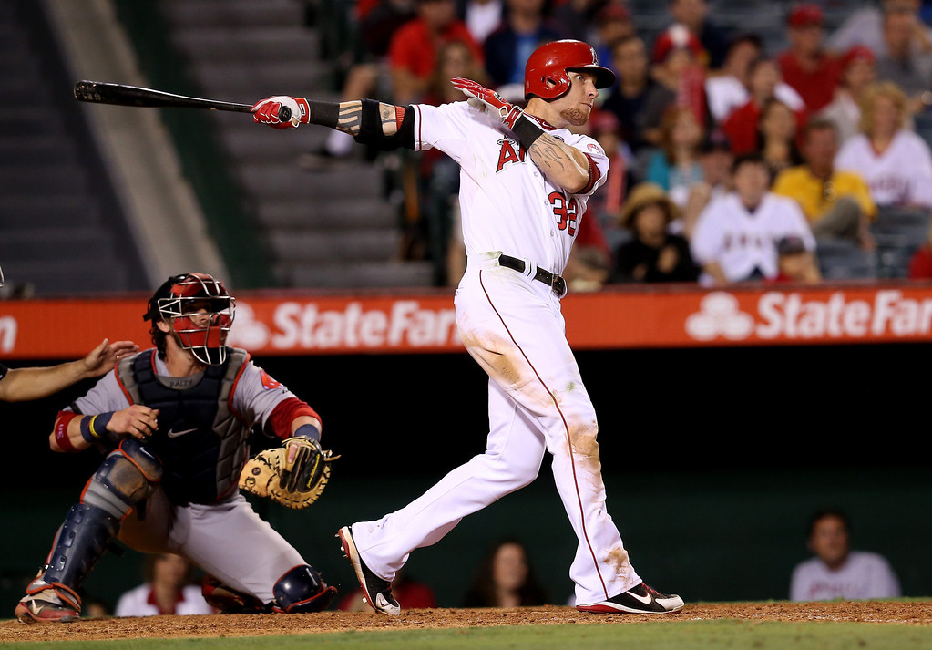 . JULY 6: Hamilton rebounded from his defensive miscue the day before by singling in a run in the Angels\' four-run ninth to send the game into extra innings against Boston. Hamilton finished the game with a two-run home run in the bottom of the 11th inning for a 9-7 Angels victory.  (Photo by Stephen Dunn/Getty Images)