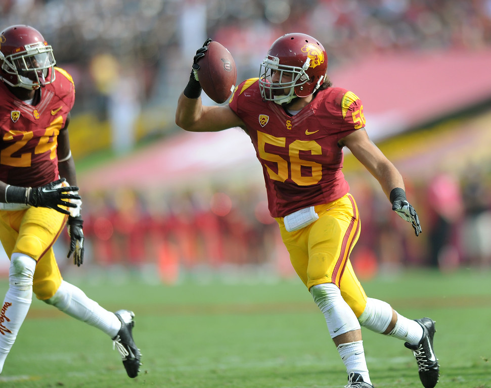 . USC\'s Anthony Sarao celebrates recovering a fumble by Utah QB Travis Wilson, Saturday, October 26, 2013, at the L.A. Memorial Coliseum. (Michael Owen Baker/L.A. Daily News)