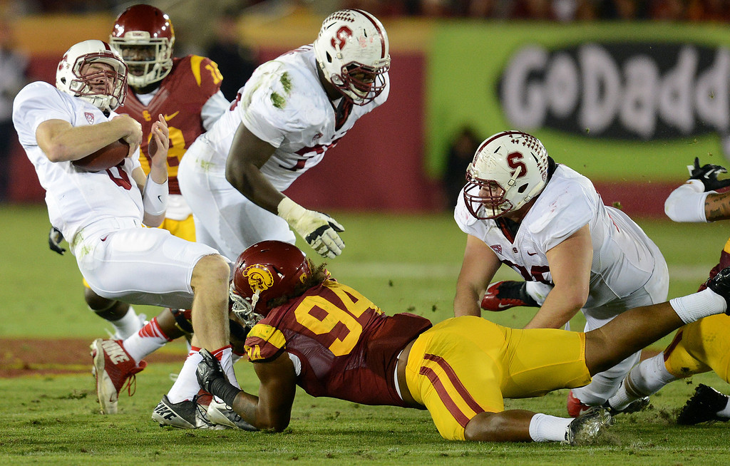 . USC�s Leonard Williams #94 drags down Stanford QB Kevin Hogan #8 during their game at the Los Angeles Memorial Coliseum Saturday, November 16, 2013. (Photos by Hans Gutknecht/Los Angeles Daily News)