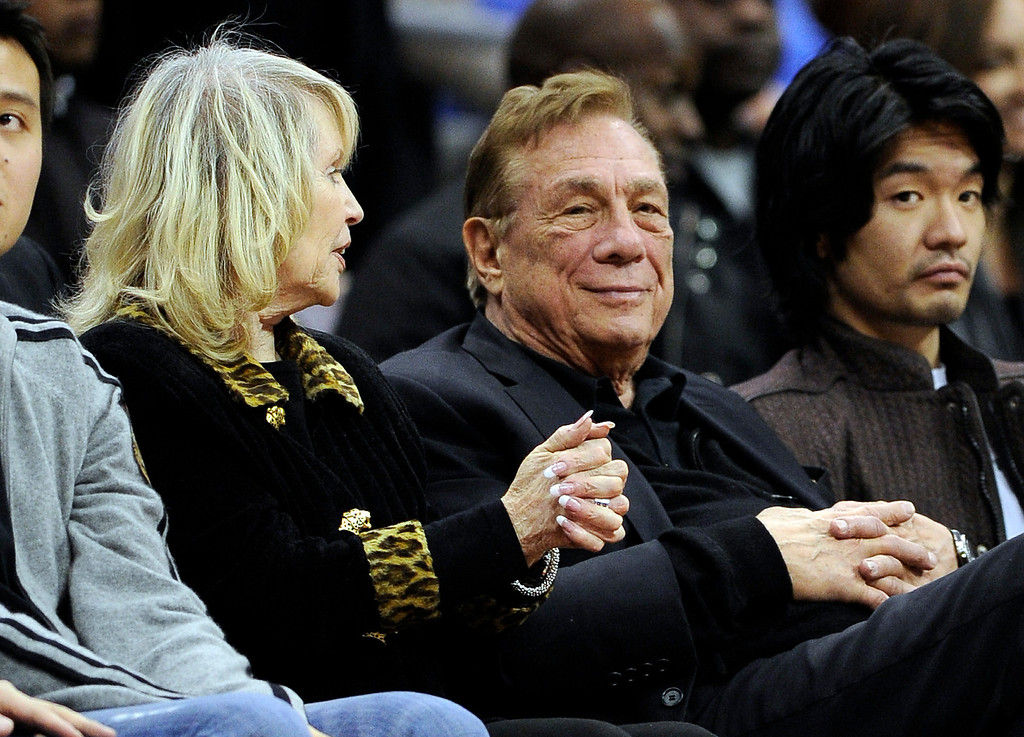 . Los Angeles Clippers owner Donald T. Sterling, center, sits with his wife Rochelle during the second half of their NBA basketball game, Wednesday, Jan. 5, 2011, in Los Angeles. The Clippers won 106-93. (AP Photo/Mark J. Terrill)