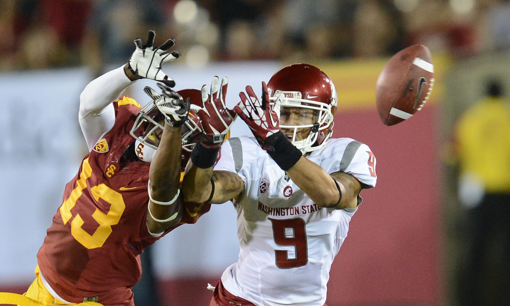 . USC\'s Kevon Seymour #13 breaks up a pass intended for Washington State\'s Gabe Marks #9 at the Los Angeles Memorial Coliseum  Saturday, September 7, 2013.  (Photo by Hans Gutknecht/Los Angeles Daily News)