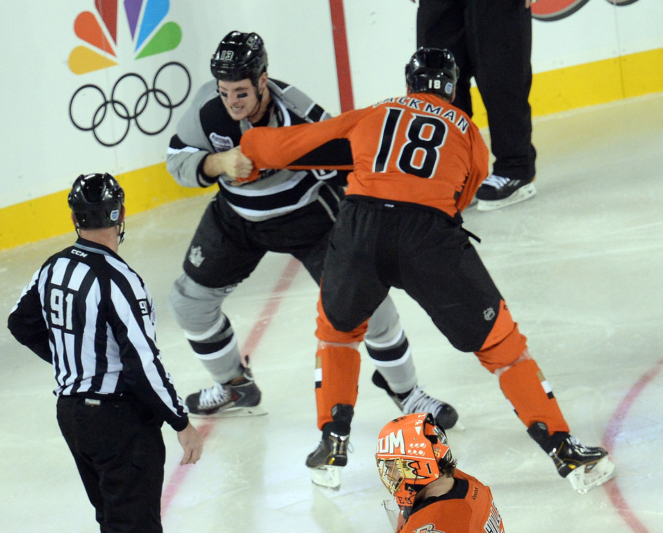 . The Kings� Kyle Clifford and the Ducks� Tim Jackman fight during the 2014 NHL Stadium Series featuring the Los Angeles Kings taking on the Anaheim Ducks at Dodger Stadium January 25, 2014. (Photo by Hans Gutknecht/Los Angeles Daily News)