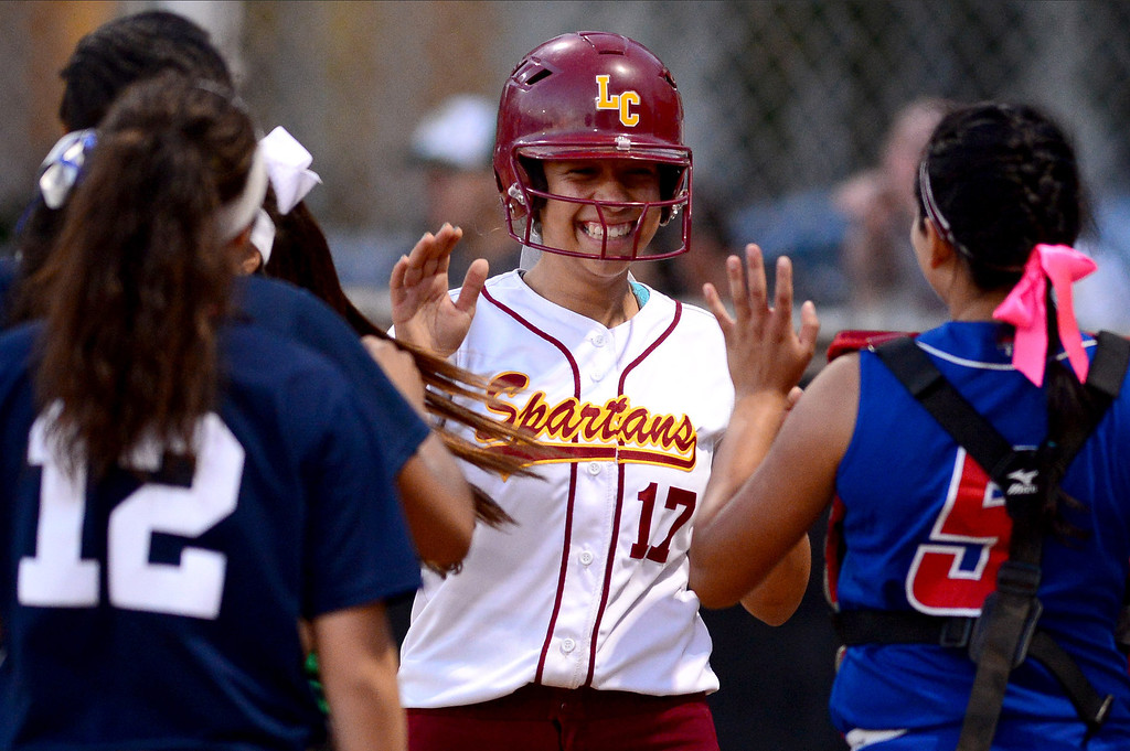 . La Canada\'s Olivia Leyva (17) brings in a 3 run home run during the West SGV softball all-star game Wednesday night, June 11, 2014 at Live Oak Park in Temple City. (Photo by Sarah Reingewirtz/Pasadena Star-News)
