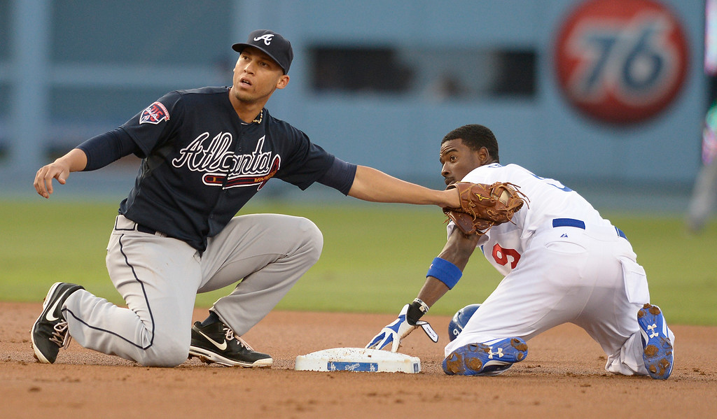 . Dee Gordon steals 2nd base in the 1st inning when Andrelton Simmons got the throw late. The Dodgers played host to the Atlanta Braves in a game played at Dodger Stadium in Los Angeles, CA. 7/30/2014(Photo by John McCoy Daily News)