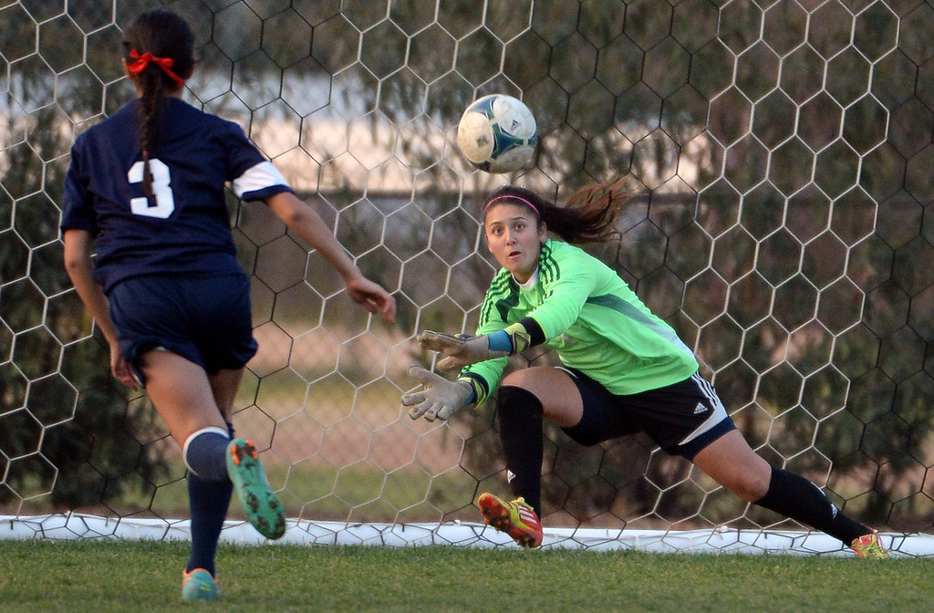 . Bishop Amat goal keeper Evelyn Fierros eyes a Marshall shot in the second half of a prep soccer match at Bishop Amat High School in La Puente, Calif., on Thursday, Jan. 9, 2014.Amat won 3-0. (Keith Birmingham Pasadena Star-News)