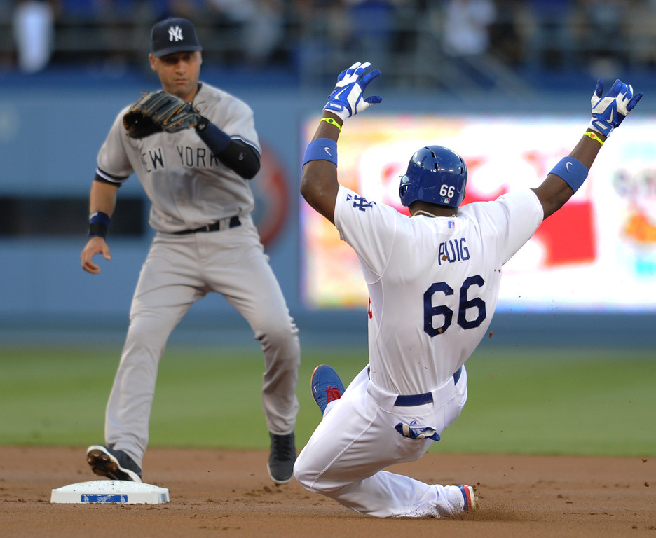 . Dodgers Yasiel Puig slides safely into 2nd base after he connected on this pitch from Yankees Andy Pettitte for an off the wall double in the 1st inning. The Dodgers played the NY Yankees in a game at Dodger Stadium in Los Angeles, CA. 7/30/2013(John McCoy/LA Daily News)