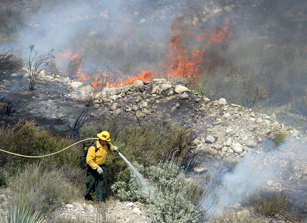 . U.S. Forest Service Firefighters battle the Etiwanda Fire as it moves through Rancho Cucamonga,Ca., Wednesday. The brush fire burned over 1,000 acres threatening homes, forcing residents to evacuate and schools to close. (Photo by John Valenzuela/Inland Valley Daily Bulletin)