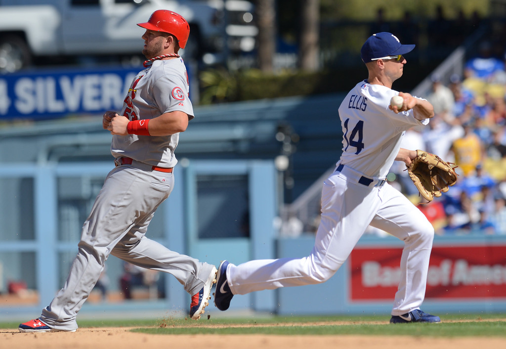 . The Dodgers\' Mark Ellis turns a doube play behind Matt Adams of the Cardinals in game 5 of the NLCS at Dodger Stadium Wednesday, October 16, 2013.  The Dodgers won the game 6-4.(David Crane/Los Angeles Daily News)